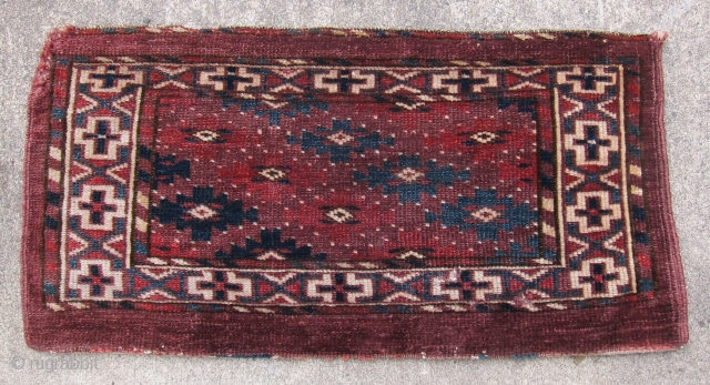 """Yomud mafrash, circa 1875, 12"""" x 24"""".  Natural dyes, symmetrical knotting, lustrous wool.  Pieces showing this design are usually attributed to the Yomud Igdyr subtribe, and are relatively rare.   ..."""