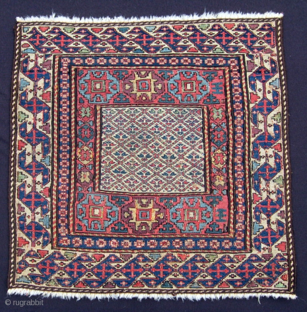 "Shahsavan sumak bagface, 3rd Qtr. 19th C., 21"" x 22"".  Am unaware of a published example of a Shahsavan sumak bag featuring this field design. Barber pole side borders are not  ..."