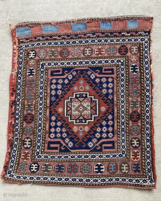 Tanavoli in his classic book: Shahsavan, exhibits a similar piece: pl. 186 .  He comments that his near identical 1/2 khordjin was woven by settled Shahsavan in Qeydar in the Khamseh  ...