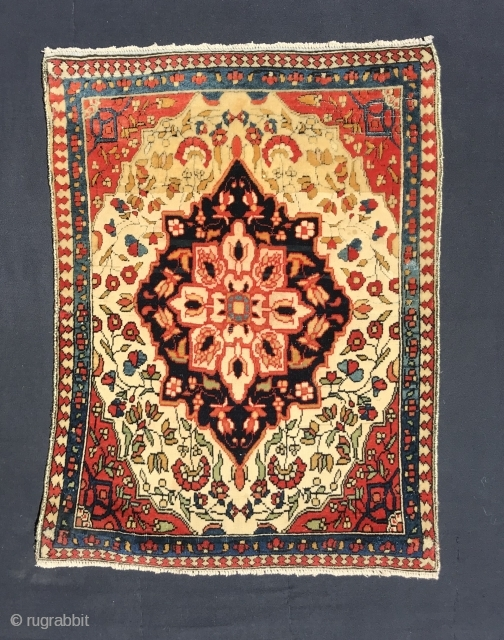 Ref 1623 Kashan pushti circa 1900 most probably Mohtashem. 90 x 44 - 3'0 x 1'6.  Good condition with purple silk overcasting.