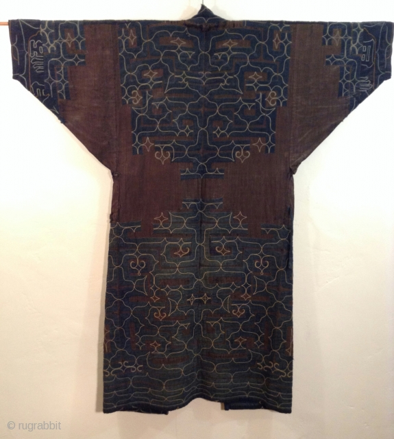 This robe was made by the indigenous people living on the northern most island of Japan. Both men and women wore these robes which are a form of appliche. the blue cotton  ...