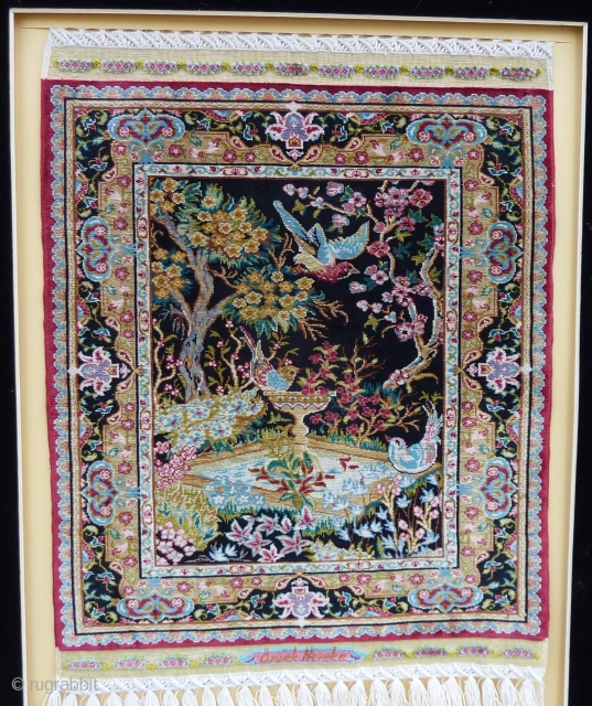 Fine 15 x 15 knts. p/cm. silk on silk Hereke, signed Özipek in its original frame, Seize frame:  60  x 47 cm., Seize rug: 34  x 26 cm. Mint  ...