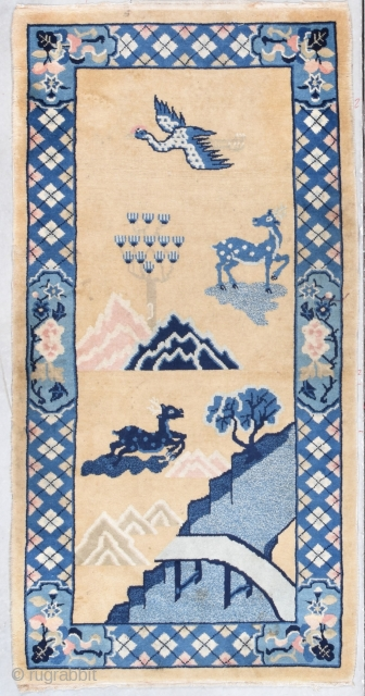 """This circa 1940 Peking Chinese Oriental Rug measures 2'7"""" X 5'0"""". It has a Mongolian design with a tan colored background. The bottom right corner has a bridge going over a river  ..."""