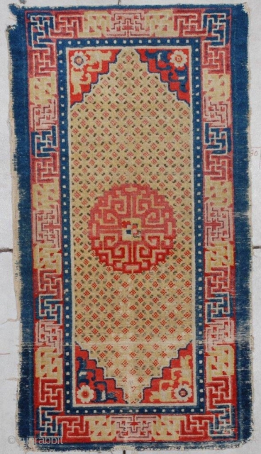 """#7140 Antique Ningxia Rug  This Ningxia measures 2'4"""" x 4'0"""". It has a center medallion in pale red with corners worked in two colors of red with floral motifs on a pale  ..."""