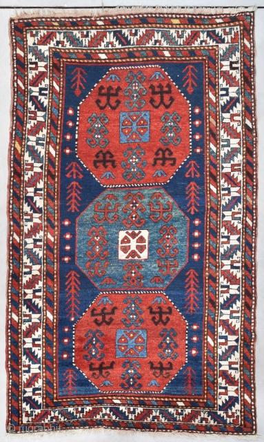 "#7734 Kazak Antique Caucasian Rug 4'7″ X7'8″ This circa 1880 Kazak Oriental Rug measures 4'7"" X 7'8"" (143 x 237cm). It has a dark blue ground with three eight sided medallions. The ones  ..."