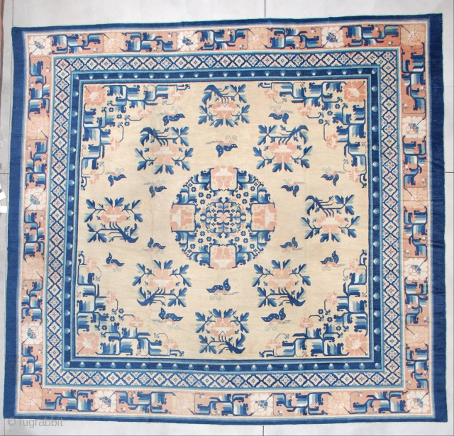 """7256 Antique Ningxia Chinese Rug This pre 1850's Ningxia Chinese rug measures a nearly square 12'3' x 11'9"""" (374.9 x 362.71 cm). The field is the color of unsalted butter. It has a  ..."""