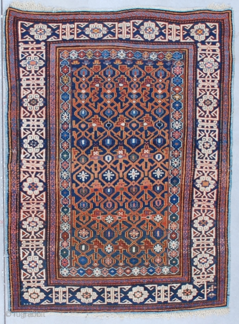 """#7554 Kuba  This circa 1870 Kuba measures 4'0"""" X 5'3"""" (121 x 161 cm). It has a blue ground with a combination latch hook and trellis design in rusty red on a navy  ..."""