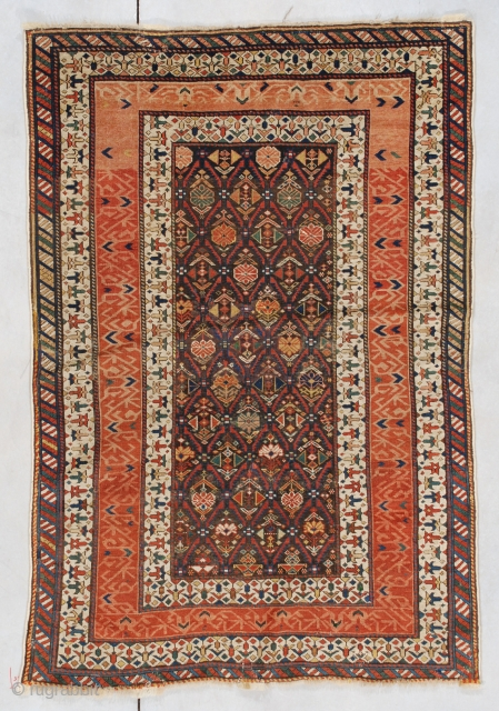 """#7461 Kuba  This circa 1850 Kuba measures 3'9"""" x 5'5"""" (114 x 165 cm). It has a lattice work motif containing a dozen different floral designs on a reddish brown ground which is  ..."""