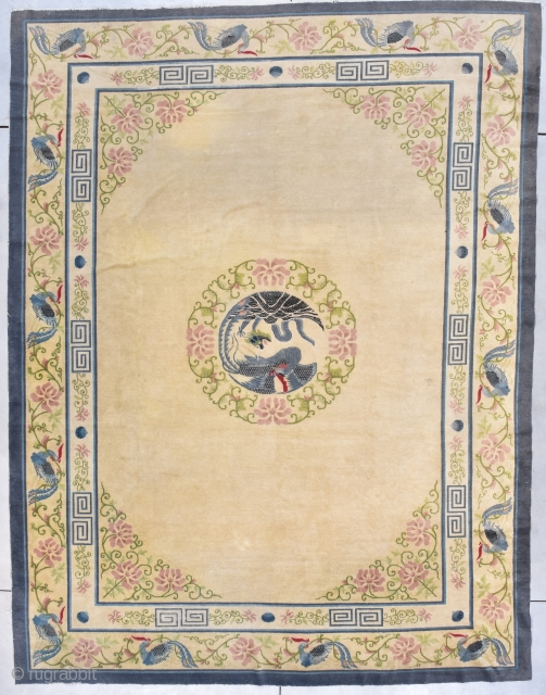 """This third quarter 19th century Peking Chinese rug measures 9'1"""" X 11''10"""" (277 x 363 cm). It has an old ivory colored field with a central medallion in the form of a  ..."""
