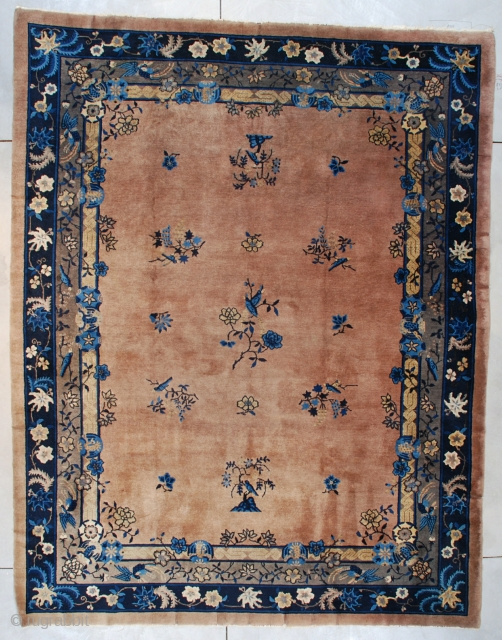 """#7544 Peking Chinese Rug This circa 1900 Peking Chinese rug measures 9'0"""" X 11'10"""" (274 x 365 cm). It has a café au lait colored ground with several different foliage motifs such as  ..."""