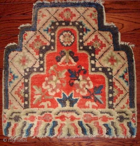 """#6728 Tibetan Chair Back This late 19th century Tibetan chair back measures 1'8"""" x 1'7"""" (54 x 64 cm). It has a scalloped field mirroring the edges of the chair back, and a  ..."""