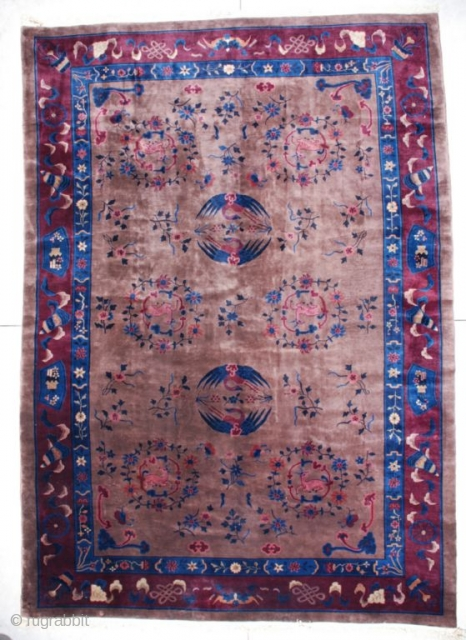 """6776 Art Deco Chinese Rug This circa 1910 Mandarin quality Art Deco Chinese rug measures 10'0"""" X 14'3"""". It has a milk chocolate colored field with two pairs of circling cranes in two  ..."""