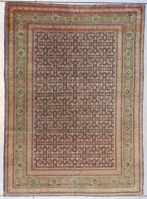 """#7631 Fereghan Sarouk This circa 1890 Fereghan sarouk measures 5'9' X 8'0"""" (179 x 243 cm). It has a beautifully drawn Herati motif in pale blue and rust on a dark blue ground.  ..."""