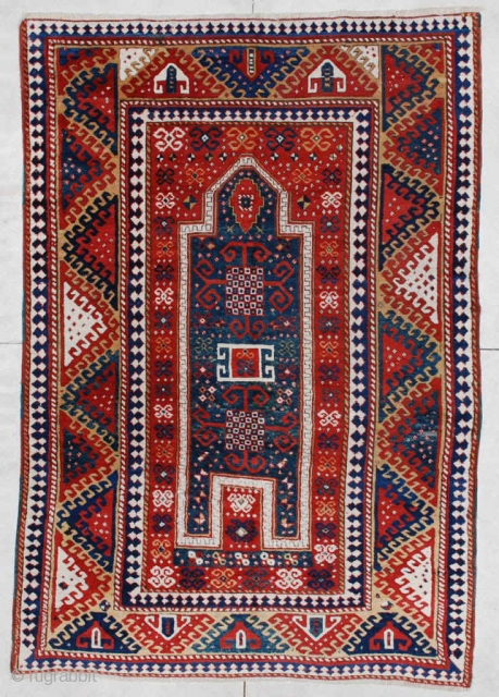 """This circa 1860 antique Caucasian Borchalou Kazak rug measures 5'4"""" X 7"""". It is a nice big Kazak and the only prayer Borchalou I have ever seen. The prayer design is in  ..."""