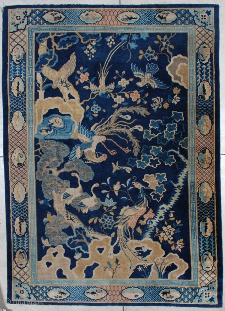 """#7192 Peking Chinese Rug  This antique Peking Chinese rug measures 6'1"""" X 8'7"""". It has a dark blue field completely overwhelmed with activity.  There is a large rockery in camel hair and  ..."""