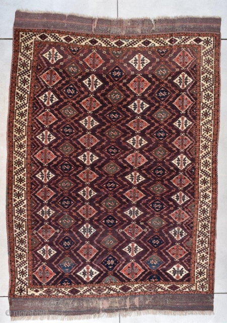 """#7770 Chodor  This Turkoman Chodor Oriental Rug measures 6'8"""" X 9'3"""" (203 x 282 cm). It has a medium to dark chocolate brown field with a diamond shaped motif in pale red, beautiful  ..."""