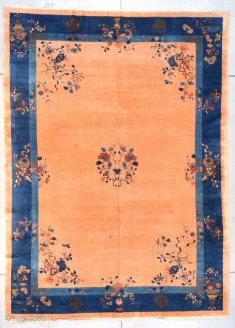 """#7677 Peking Chinese Rug This circa 1900 Peking Chinese Oriental rug measures 9'0"""" X 12'5"""" (274 x 381 cm). It has a small medallion of a wreath of flowers on a field color  ..."""