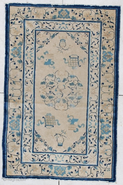 """#5895 Antique Peking Chinese Rug This circa 1870 Peking Chinese rug measures 3'1"""" x 4'9"""". It has flower vases, a book, a writing dish and a small center medallion on an ivory ground,  ..."""