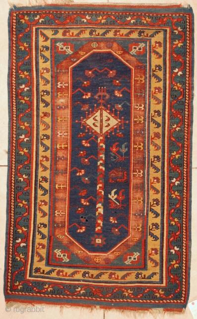 #6020 Megri Antique Turkish Rug  This mid 19th century Megri or Makri antique Oriental carpet measures  3'3″ x 5'3″ (100 x 161 cm). It has a single panel in blue with  ...