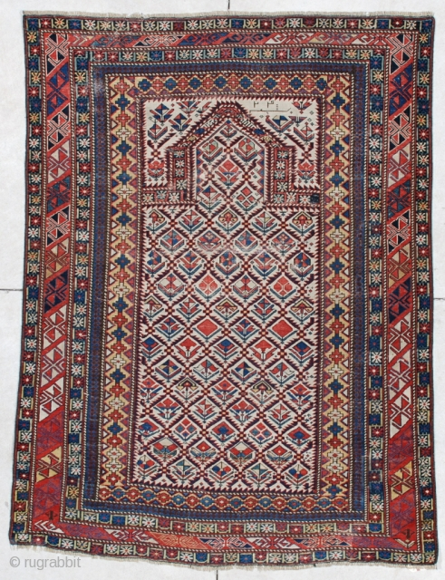 """#6091 Marasali Shirvan This Marasali Shirvan rug measures 4'0"""" x 5'6"""". It has a prayer design on an ivory field with a lattice design. Each opening in the lattice has a different  ..."""
