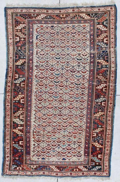 """#6160 Kuba Antique Caucasian Rug  This circa 1880 Kuba antique Oriental Rug measures 3'5"""" X 5'4"""". It has a lattice design containing different colored flowers on an ivory field. The border is  ..."""
