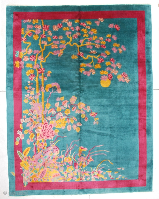 """This circa 1920 Art Deco Chinese rug measures 8'11"""" X 11'5"""". It is the darkest teal green with a red border. It has a rockery in the lower left hand corner in  ..."""
