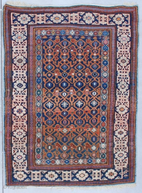 """This circa 1870 Kuba measures 4'0"""" X 5'3"""" (121 x 161 cm). It has a blue ground with a combination latch hook and trellis design in rusty red on a navy field  ..."""