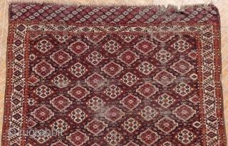Chaudor/ Chodor Main Carpet, 11ft x 7.7ft. (335 x 235 cm.) late 19 th. century. Characteristic Ertmen Gol design on dark purple-brown ground. SOLD!