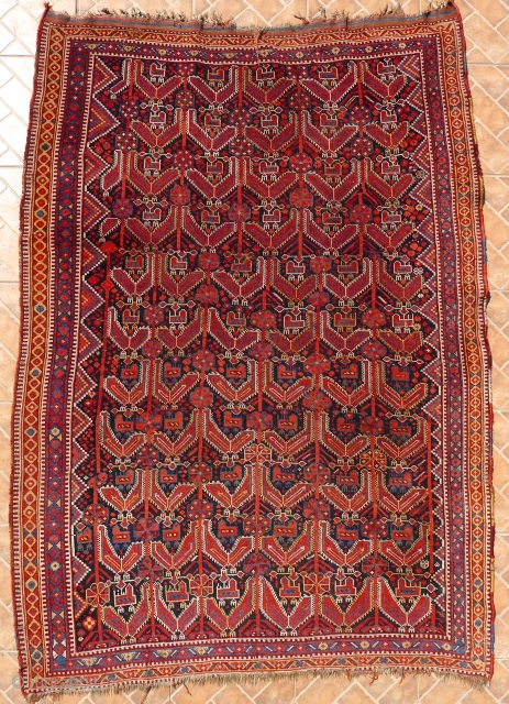 "An atypical Khamseh Bird Rug, showing the chicken on top of the hen. In principle, similar to the Khamseh ""Mother and Child"" Boteh design. General good condition with slight overall wear and  ..."