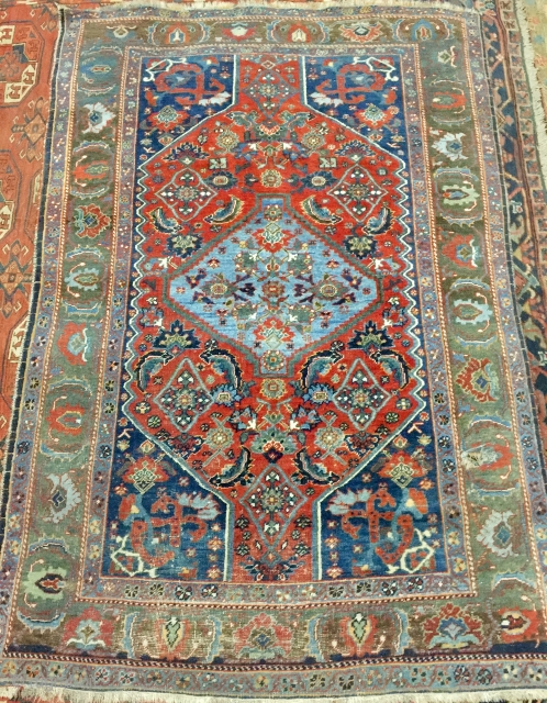 A Persian antique rug with beautiful green bordure...Available...