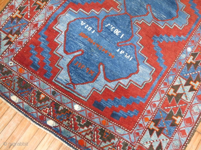 Antique Kazak.  Dated 1903. 5'2''x8' Very cool.  Has one area thats a little low and oxidezed.  Other than that its mint and original.