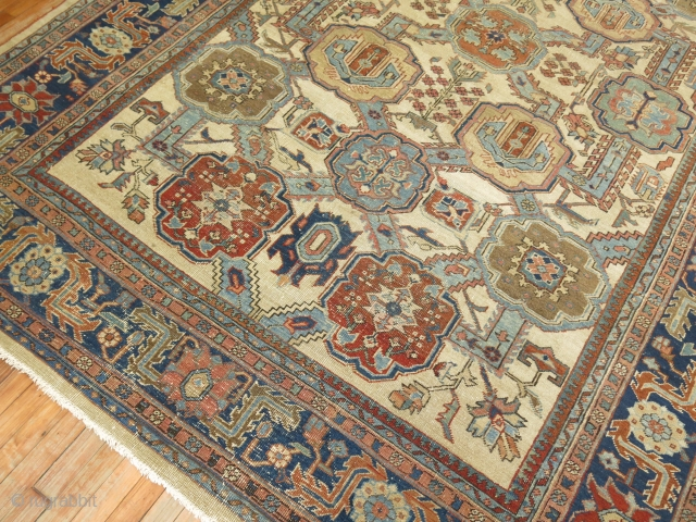 Antique Heriz 8'x11'3''.  Has some scattered low areas.  Ivory field with rare all over design.
