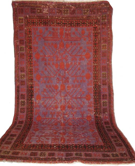 Khotan rug needs repair measuring 243 x 121 cm.