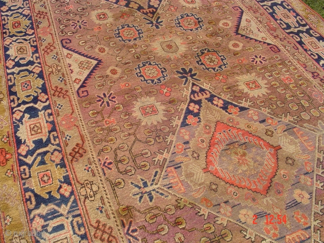 Yarkand rug minor repaired areas measuring 12.5 x 6.5 feet.