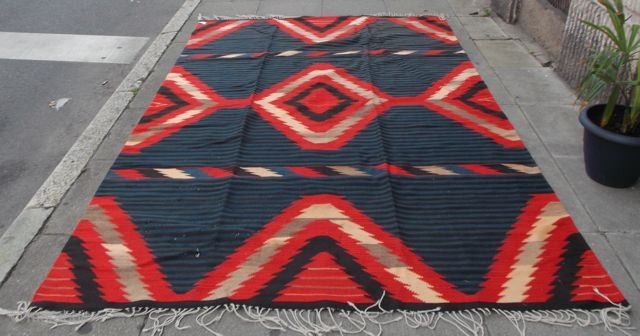 Navaho cover, small holes from moth, overall good condition