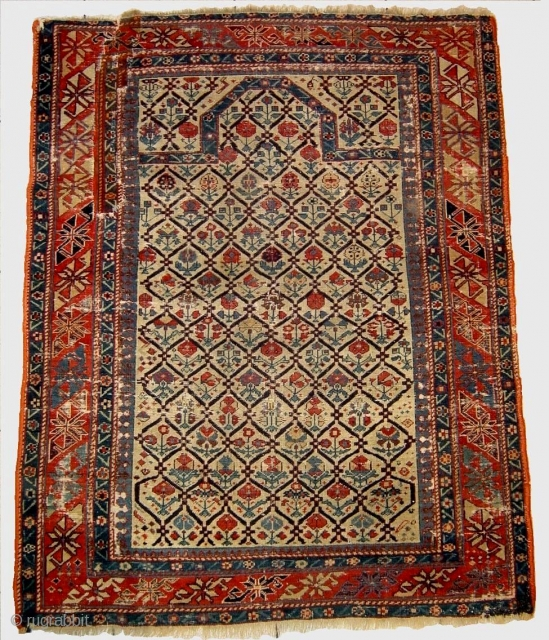 Early caucasian prayer rug, wth silk wefts and a few knots of silk highlights in the field