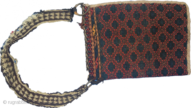 Antique Kelat bag 38x27cm. Beautiful rich colours. Charming piece with the iron ring and handle. Some losses to the handle.