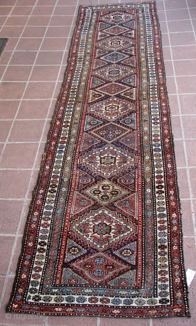 "Antique 2' 10"" x 13' 10"" Kurd.  Lays straight; In low to medium pile condition, with the original end webbings having been sewn underneath. Two very small replied areas on one  ..."