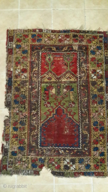 This 19'th century piece is from city Konya - Ladik province. Wool on wool foundation.  It is a prayer rug. Ladik is a well known rug producing centre.  Dimensions are 100 CM X 150  ...