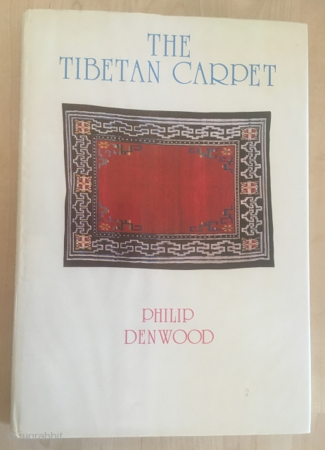Philip Denwood - The Tibetan Carpet  First edition Fine unblemished book in great condition. Dw slightly wrapped at top and price-clipped. Some small scuffs to front of dw else VG. Illustrated by 24  ...