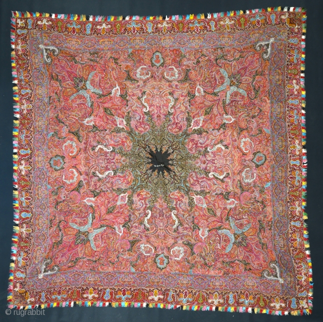 a Very fine XIXth C. Kashmir Shawl in pristine condition. Full color spectrum, including at least two aubergine purples, several reds, apricot, several greens, etc. Approx 70 x 70 inches.