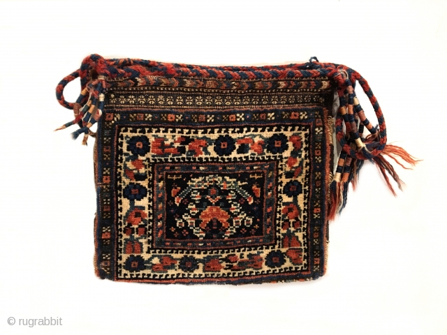 """Antique Afshar Chanteh. Early 20th Century. Rare and fully intact small bag. A tribal treasure. Chevron kilim back. Mint condition considering age. Original sides. 7 colors. 1'0"""" x 1'1"""". Carefully hand washed."""