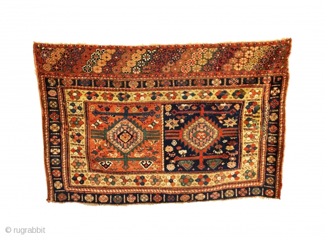 Antique Kurdish Juval (Chuval). 3rd Quarter 19th Century. 'Jaf' style. Two dynamic panels of colorful ashiks with arms and crosses surmounted by a rosette skirt. Note: lambs and flying chickens in field.  ...