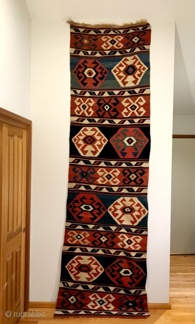 "Antique Caucasian Kilim.  2nd Half 19th Century.  Mint condition.  Soft dungaree handle.  Original macrame braided end.  7 colors.  Strong green.  10'9"" x 3'0"".  Delicately  ..."
