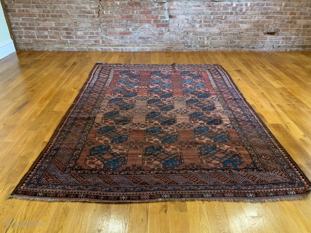 Antique Ersari Main Carpet. Late 19th Century. The field is arranged with a 3x7 row format of Gulli Gols that vary in size. Of special note is the three shades of abrash  ...