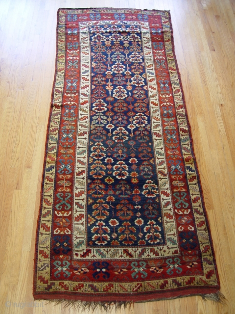 "4'1"" X 10'6"" Kurdish rug, circa 1870's , dark blue background color, no repairs."
