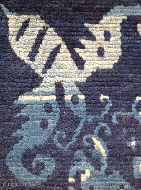 Indigo Khaden. Tibetan copy of Chinese Baotoa carpet. Circa 1900. Beautifully drawn with mosquito/bats in the corners. Brilliant use of indigo dye. 32x59 inches