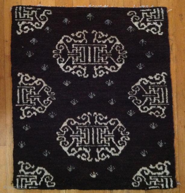 Tibetan sitting mat Circa 1900 Natural brown wool with natural ivory and indigo   21 x 24 inches