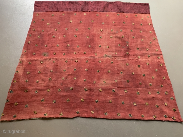 Horse blanket from Tibet. Nambu textile with embroidered thigma cross. Has some butter tea stains and should be washed. Around 1920, 122 x 104 cm.