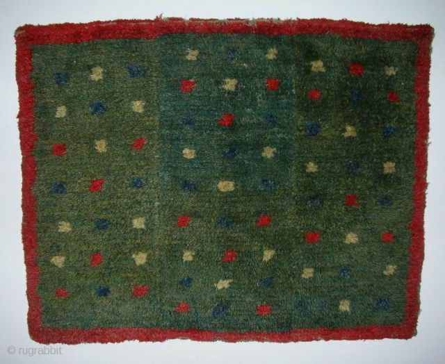 MAT, Tibet, early 20th century, cm 76x62. Tibetan rugs in so-called 'tsuk-truk' technique (woven in narrow stripes - then joined - on small back strap looms) are probably the survivors of a nearly  ...